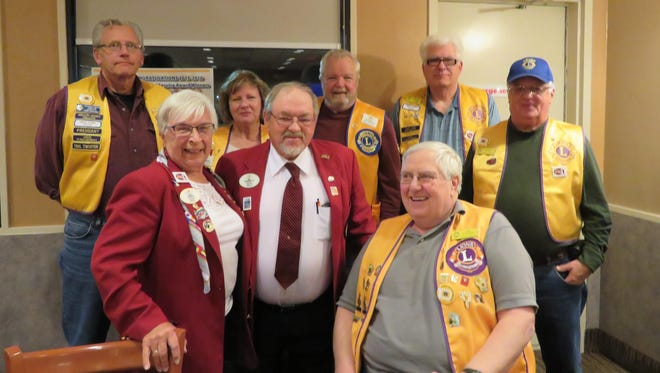 """An inspiring """"Centennial Service Challenge"""" presentation, plus special Club awards, were given by District Governor Diane Wasniewski at the Rothschild-Weston Lions Club's meeting. Pictured in the top row are Dennis Borchardt, past president, from left, Betty Thompson, secretary, Jim Thompson, tail twister, Mike Roosevelt, district cabinet secretary, and Eugene Helke, second vice president. Pictured in the bottom row are Diane Wasniewski, district governor, Emil Wasniewski, past district governor, and Dan Glodowski, first vice president."""
