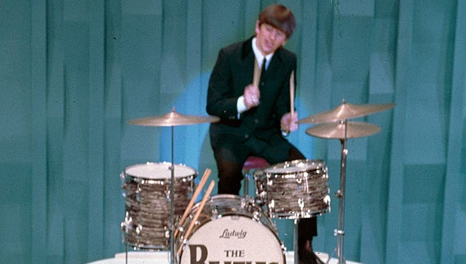 "Ringo Starr performs with the Beatles on ""The Ed Sullivan Show"" in 1964."