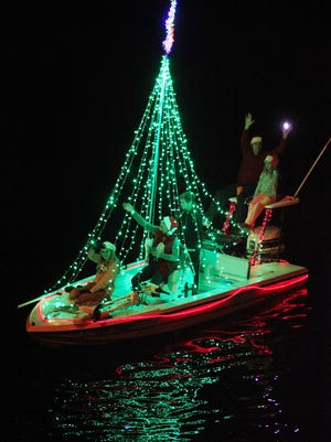 A participant in the 29th Annual Bonita Springs Christmas Boat Parade makes its way down the Imperial River.