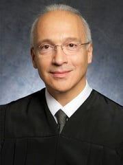 This undated photo provided by the U.S. District Court shows Judge Gonzalo Curiel. Trump is scheduled to go on trial this month in a class-action lawsuit against him and his now-defunct Trump University, potentially taking the witness stand weeks before his inauguration as president of the United States. U.S. District Judge Curiel, the Indiana-born jurist who was accused of bias by Trump during the campaign for his Mexican heritage, will hold a hearing Thursday, Nov. 10, 2016, on jury instructions and what evidence to allow at trial.