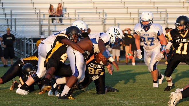 Chester County's B.J. Burton (1) stretches for more yardage against Trenton Peabody during a scrimmage on Friday.
