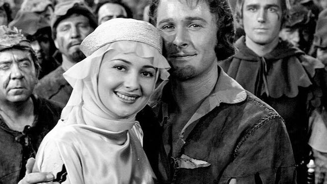 "Olivia de Havilland and Errol Flynn in ""The Adventures of Robin Hood."""