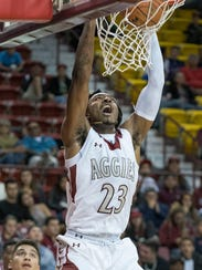 New Mexico State's Marlon Jones gets the dunk on the