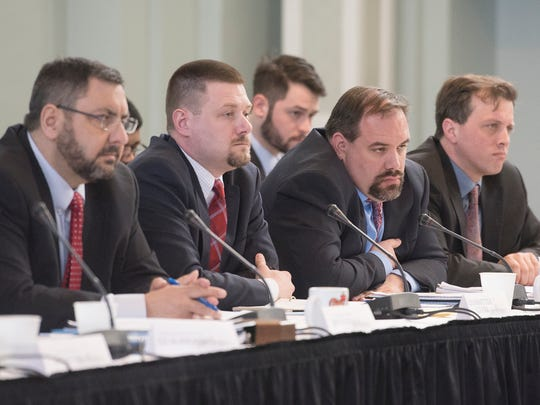 Members of the Michigan Joint Committee on the Flint Water Public Health Emergency including State Sen. Jim Stamas, Committee Clerk Scott Jones, State Sen. Jim Ananich and State Rep. Jeff Irwin listen to testimony.
