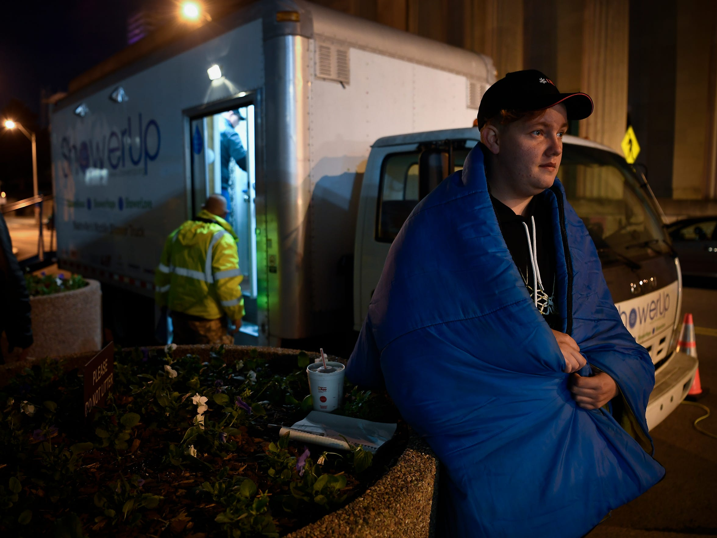 Damon Sanderson, 24, waits for a haircut outside a mobile shower truck for the homeless parked on Seventh Avenue on Oct. 23, 2017, in Nashville. Sanderson was kicked out of his home when he was 15 after coming out as gay to his mother.