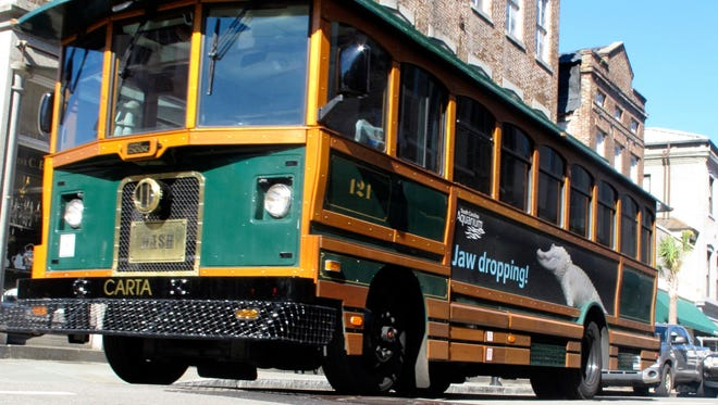 A trolley bus makes its way through the historic district in Charleston, S.C., Thursday, Nov. 18, 2010.