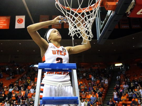 UTEP senior guard Cameasha Turner cuts a piece of net off the rim after the Miners' 94-91 double overtime win over Charlotte on Saturday in the Don Haskins Center. The victory earned the Miners the regular season C-USA title.