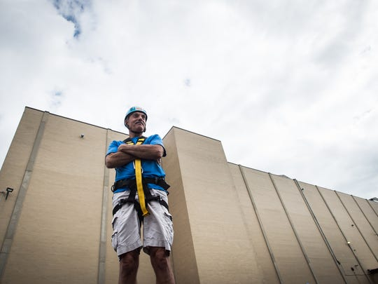 Youth For Christ Executive Director Jerry Higley poses for a picture with his rappelling gear on in front of the APR Supply Company on Saturday, August 5, 2017. Higley will go over the edge to raise funds for YFC.