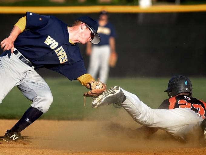 Mount Wolf's Jimmy Losh reaches for the tag as Stoverstown's