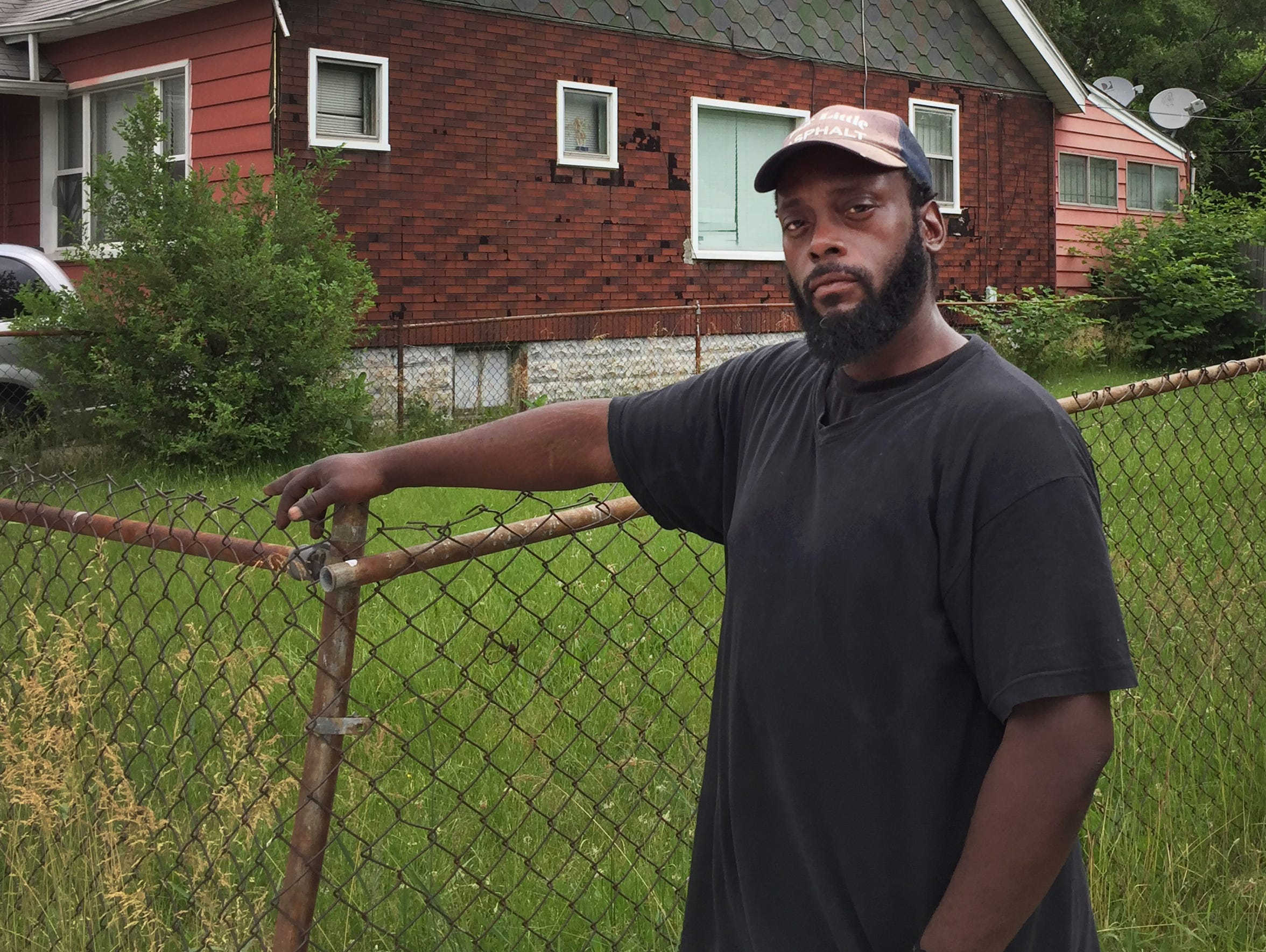 Jamon Blue, 38, a Fitzgerald neighborhood resident, poses in June for a portrait on Prairie Street.
