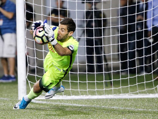 FC Cincinnati goalkeeper Mitch Hildebrandt (1) blocks