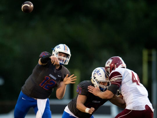 Campbell County's Zach Rutherford throws to an open