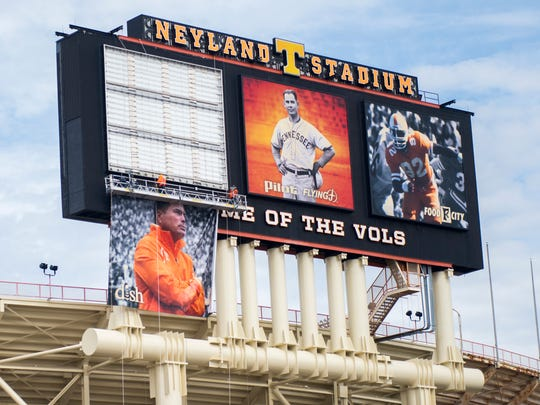 The photo of former Tennessee football coach Butch Jones is taken down from Neyland Stadium's scoreboard March 5, 2018.