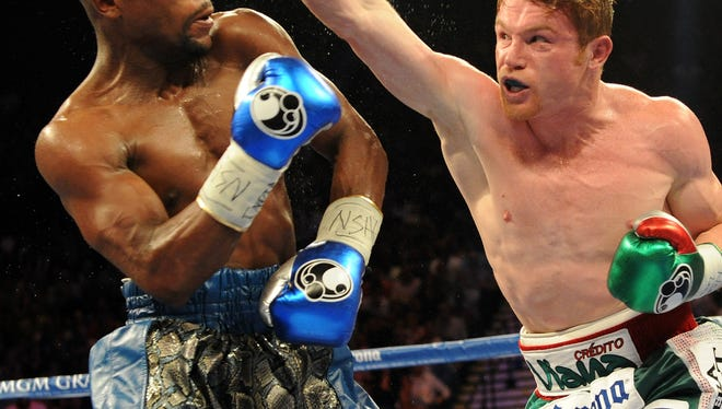 Floyd Mayweather and Canelo Alvarez battle during their during their super welterweight title fight at MGM Grand Garden Arena Saturday
