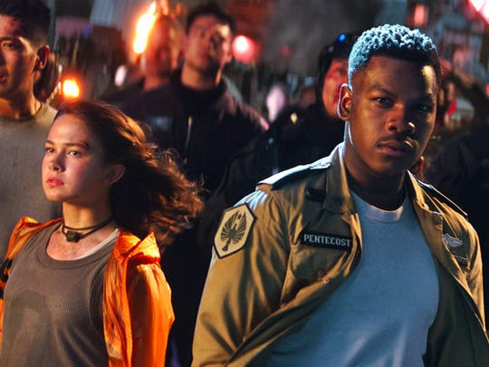 "From left, Cailee Spaeny, John Boyega and Scott Eastwood star in ""Pacific Rim Uprising."""
