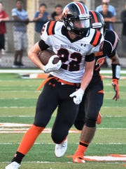 Northville wide receiver Jack Peterson (22) finds daylight against Dearborn.