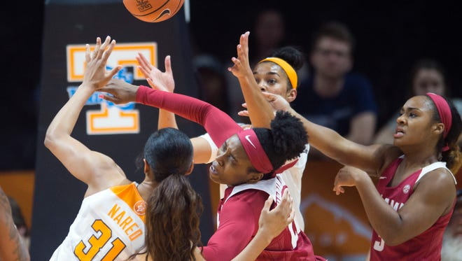 Much like the basketball Tennessee's Jaime Nared, left, and Evina Westbrook pursued against Alabama last week, Tennessee's NCAA tournament seeding still is up in the air.