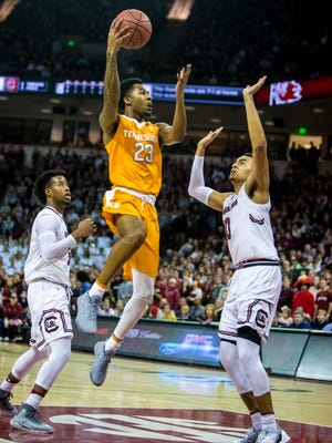 Vols guard Jordan Bowden (23) drives over South Carolina forward Justin Minaya (10) in the first half Saturday.
