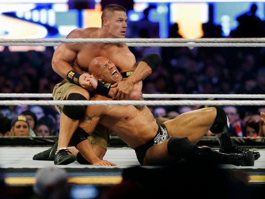 John Cena chokes out Dwayne Johnson at WrestleMania