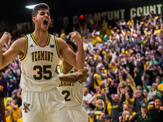 UVM's Payton Henson reacts to drawing the foul after sinking a layup late in last year's America East final.