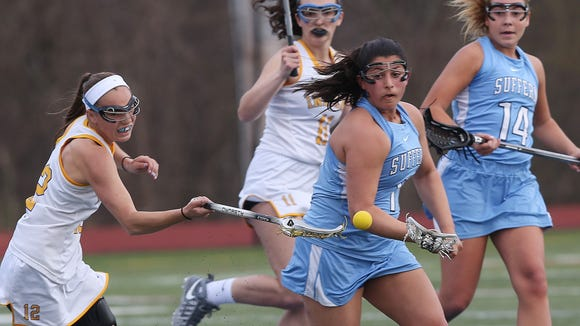From left, Mahopac's Kristen Maxwell (12) and Suffern's Allison Iodice (11) battle for ball control during girls lacrosse action at Mahopac High School April 20,  2017. Suffern won the game 14-6.