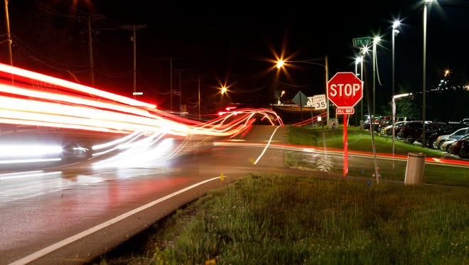 Head and tail lights streak through the intersection of North Columbus Street and Ety Road Friday night, June 22, 2018, in Lancaster.