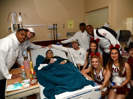 New Mexico State players visited children on Wednesday