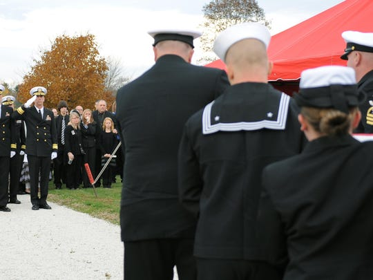 U.S. Naval officers carry Raymond Border's casket to its resting place for the graveside ceremony.
