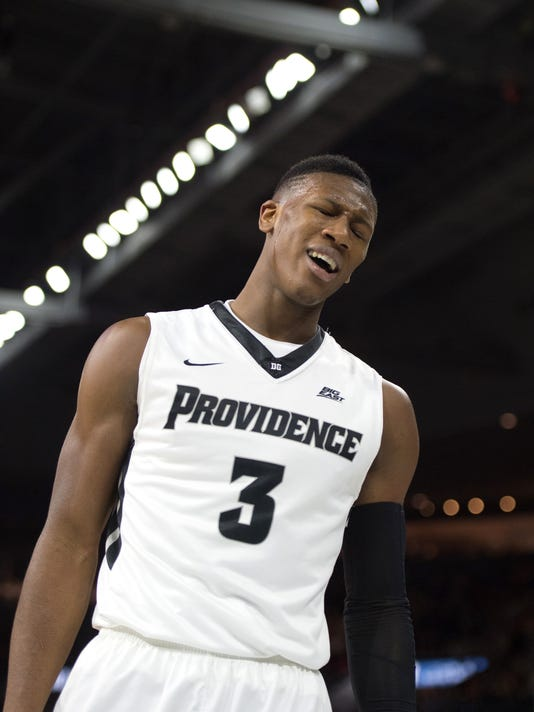 Providence guard Kris Dunn (3) reacts to a call during the second half of an NCAA basketball game against Villanova, Saturday, Feb. 6, 2016, in Providence, R.I.  Villanova beat Providence 72-60.(AP Photo/Gretchen Ertl)
