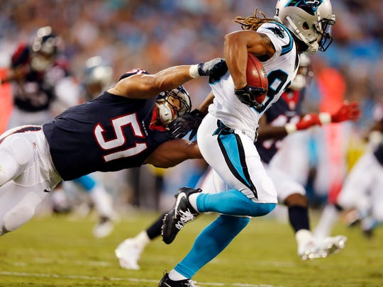 Houston Texans linebacker Dylan Cole attempts a tackle on Carolina Panthers wide receiver Kaelin Clay during the first half of an NFL preseason football game.