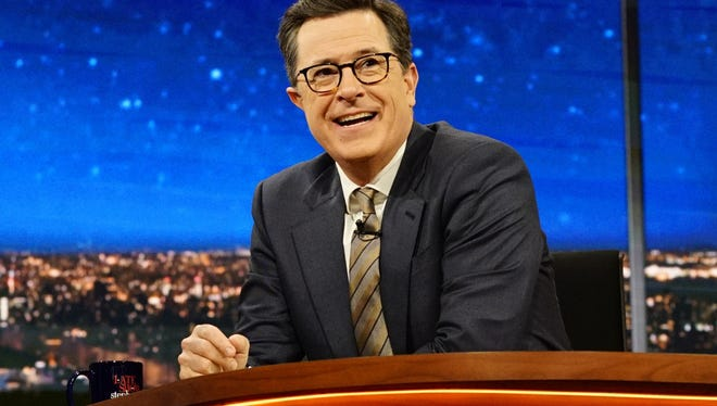 """In this March 31, 2017 photo released by CBS, host Stephen Colbert appears on """"The Late Show with Stephen Colbert"""" in New York. Colbert won in the Nielsen company's ratings for the ninth consecutive time last week, his margin of 400,000 viewers the widest lead since the CBS star overtook Fallon with a sharp concentration on politics. Fallon aired a rerun Friday, otherwise the shows were all fresh last week. (Richard Boeth/CBS via AP)"""