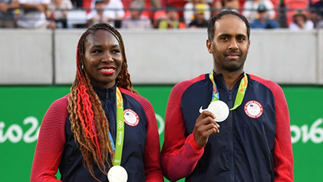 Rajeev Ram (right) and Venus Williams show off their silver medals in mixed doubles.