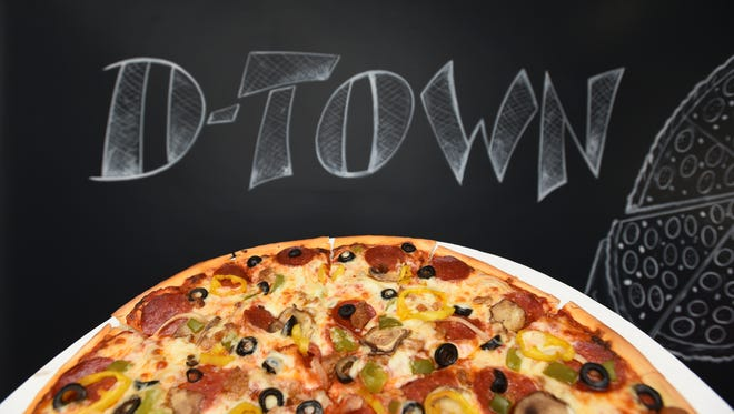 The supreme pizza at Kennedy's D-Town Pizza in Dresden features cheese, pepperoni, sausage, mushrooms, onion, green pepper, black olive and banana pepper.
