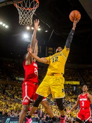 Michigan guard Muhammad-Ali Abdur-Rahkman (12), defended