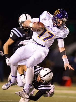 Johnston's Reid Sinnett is corralled by Valley's Zack Grasso in the first quarter Monday at Valley Stadium. The Tigers pulled away from the Dragons for a 35-7 second-round triumph.