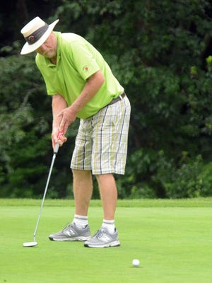 Jim Sowders sinks his putt during the 94th Norwich Invitational at the Norwich Golf Course on Friday. Sowders won the championship in 1999. See more photos at NorwichBulletin.com