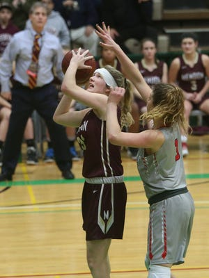 Pittsford Mendon's Caroline Cullinan, with her head bandaged, puts up a shot in the final seconds with Jamesville-DeWitt's Julia Kelner covering her, during the girls Class A state championship game at Hudson Valley Community College in Troy on March 18, 2017.