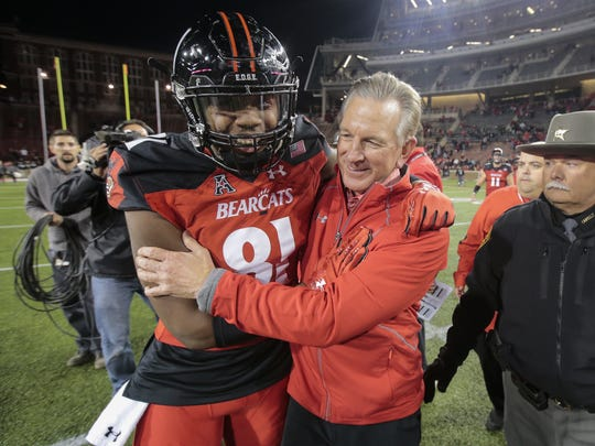Cincinnati Bearcats tight end DJ Dowdy (81) and Cincinnati Bearcats head coach Tommy Tuberville embrace after the 31-19 win against East Carolina Pirates, Saturday, Oct. 22, 2016, at Nippert Stadium in Cincinnati. Cincinnati won 31-19.