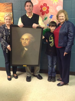 Second Vice Regent Lanetta Groves holds a DAR-donated portrait of George Washington with Union Elementary principal Danny Sullivan, student Jackie Taylor Lancaster, and DAR member Jackie Lancaster.