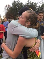 Ashwaubenon sophomore Sage Wagner hugs her father,