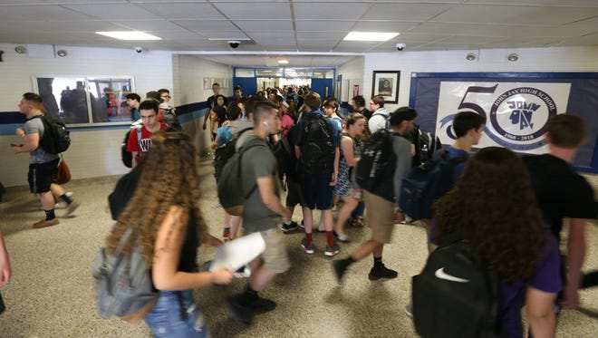 Students move to class at John Jay High School on May 9, 2018.