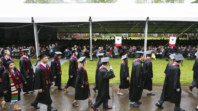 Friends and family watch as Willamette University graduates make their way to the commencement ceremony on Sunday, May 14, 2017, in Salem, Ore. This year marks the university's 175th anniversary.