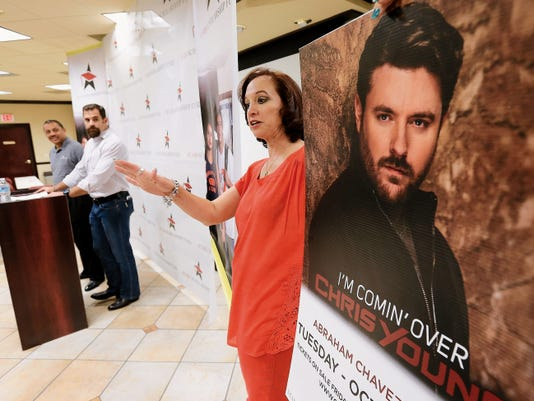 Yvette Donovan talks about Chris Young, the singer and speaker for this year's Stars Scholarship Fund 2015 El Paso Extravaganza during a press conference Monday at L&F Distributors.