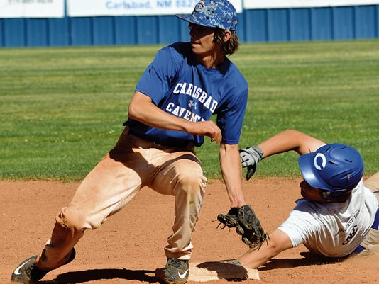Matt Hollinshead — Current-Argus Carlsbad senior third baseman Daniel Ruiz is tagged out by junior shortstop Ryan Razo during base running drills at Thursday's practice. The Cavemen can clinch the District 4-6A regular season title with a win today against Hobbs.