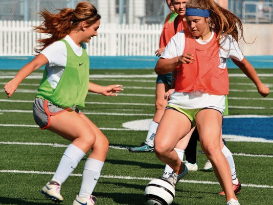 Matt Hollinshead — Current-Argus 2015 Carlsbad girls soccer grad Hannah Johns, right, trains with the team at Tuesday's practice. Johns will play soccer at Eastern New Mexico.