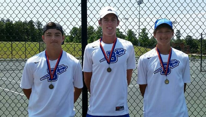 Joseph Schrader, middle, is no longer enrolled at Brevard as he pursues a pro tennis career.