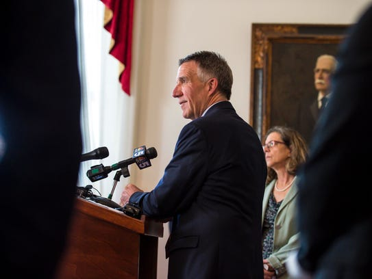 Gov. Phil Scott listens to a question during his weekly