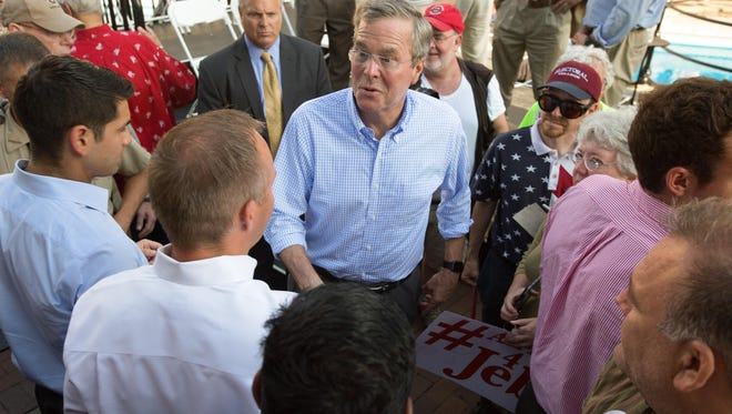 Former Florida Gov. Jeb Bush works the crowd in Pella on Wednesday, his first day of campaigning in Iowa as an officially announced presidential candidate.