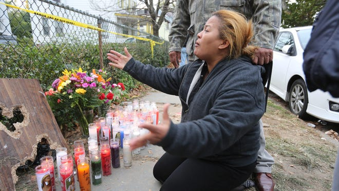 Marisol Perez cries in front of 11 S. Bond St. in Mount Vernon on Oct. 30, 2013, after four of her family members died in a fatal house fire.