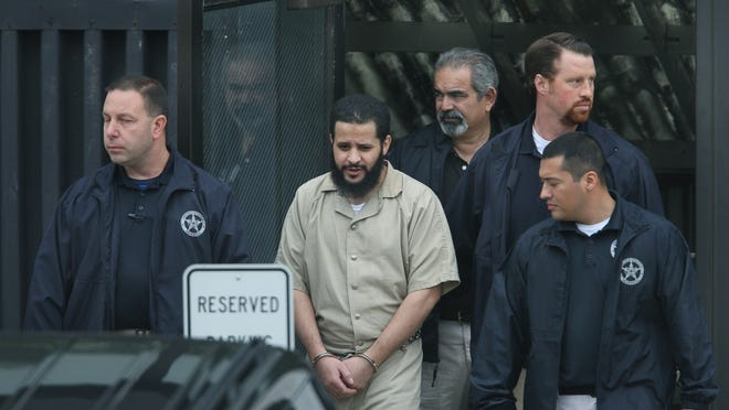 Mufid Elfgeeh is walked out of federal court Thursday in Rochester. In court Elfgeeh denied charges that he recruited fighters for the terrorist organization the Islamic State.